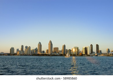 San Diego Skyline with a Sailboat at Sunset