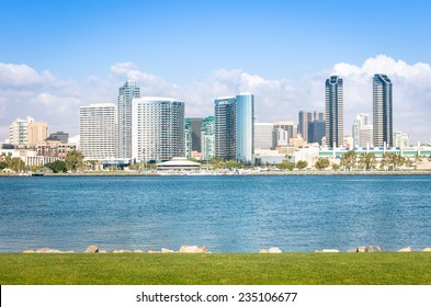 San Diego skyline and waterfront with blue water and green meadow - Skyscrapers from Coronado Island in California - United States - Travel wanderlust concept
