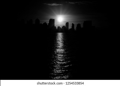 San Diego urban skyline in monochrome black and white with beautiful contours of down town cityscape with burning sun reflecting in sea water. More similar content is found in my portfolio.