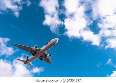 San Diego, USA, 2019. FedEx plane in blue sky. Cargo airplane, delivery concept