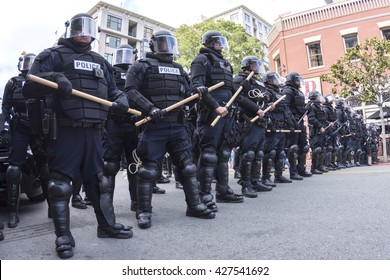 SAN DIEGO, USA - MAY 27, 2016: Riot police in full tactical gear stand ready to confront protesters at a Trump rally at the San Diego Convention Center