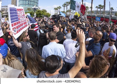 SAN DIEGO, USA - MAY 27, 2016: Media cameras frantically capture the action as anti-Trump protesters meet Trump supporters outside a Donald Trump rally at the San Diego Convention Center.