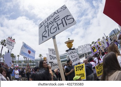 "SAN DIEGO, USA - MAY 27, 2016: The Trump rally in San Diego attracts a huge crowd of protesters many of them carrying pro-immigrant signs such as this sign reading ""Illegals have rights""."