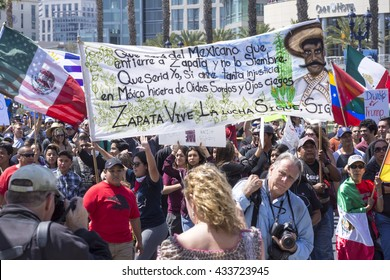 SAN DIEGO, USA - MAY 27, 2016: A huge crowd gathers to march at an anti-Trump protest in San Diego while carrying a large banner in memory of the revolutionary Emiliano Zapata.