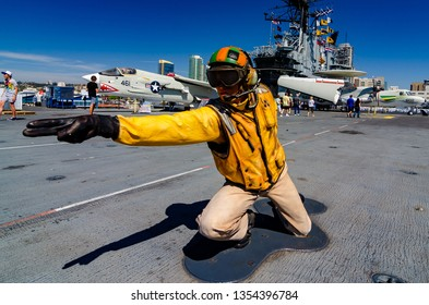 SAN DIEGO, USA - OCTOBER 4 2012: The USS Midway Museum in San Diego has interesting content including this model of a navy sailor directing plane launches