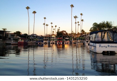 San Diego, USA : Sept 6 2018 : View of lake san marcos during the sunset. Nice reflections of the palm and boats in the lake san marcos, San Diego, California.