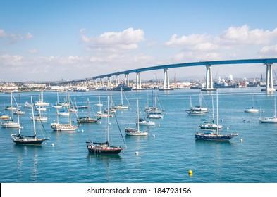 San Diego waterfront with sailing Boats - Industrial harbor and Coronado Bridge