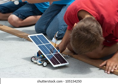 SAN DIEGO-JUNE 9:Unidentified student testing a solar car at the Junior Solar Sprint in San Diego, CA on June 9, 2012. The student solar technology & engineering event was held annually.