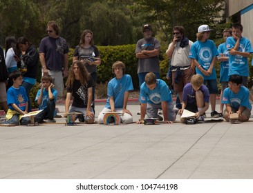 SAN DIEGO-JUNE 9:Unidentified students line up their solar cars at the start of Junior Solar Sprint in San Diego, CA on June 9, 2012. The student solar technology & engineering event was held annually