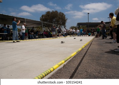 SAN DIEGO-JUNE 9:Unidentified students race solar cars at the Junior Solar Sprint in San Diego, CA on June 9, 2012. The student solar technology & engineering event was held annually.