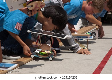 SAN DIEGO-JUNE 9:Unidentified students at the starting line of the Junior Solar Sprint in San Diego, CA on June 9, 2012. The student solar technology & engineering event was held annually.