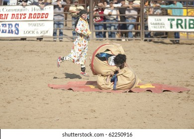 "SAN DIMAS, CA - OCTOBER 2: Robbie Hodges and his rodeo clowns ""sumo wrestle"" at the San Dimas Rodeo on October 2, 2010 in San Dimas."