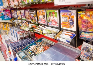 San Dimas, California/United States - 11/25/2019: A view of a several brands of sports trading cards on display at a local department store.