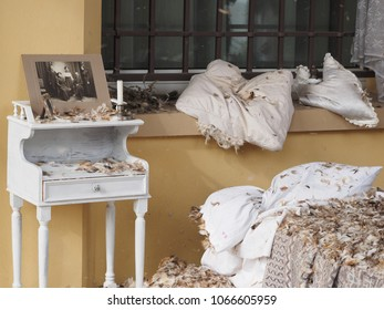 San Felice sul Panaro, Italy - Magico 2018, Magic Carnival. The theme of this year was the silent movie. Scenic set up. Shabby bedside table, bed, pillows and mattress from which feathers come out.