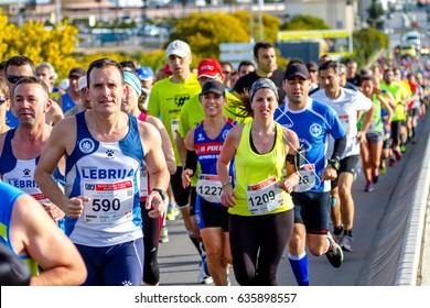 SAN FERNANDO, SPAIN - MAR 23: Unidentified runners on the street during XXVIII Half Marathon Bahia de Cadiz on March 23 , 2014, in San Fernando , Spain