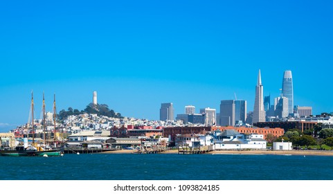 San Fracisco with three landmarks, pyramide. coit tower and saleforce building. Day time with blue sky.