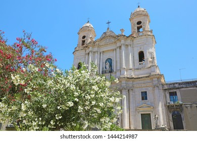 San Francesco d'Assisi all'Immacolata church with selective focus on flowered trees, Catania, Sicily, Italy