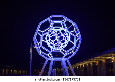 """San Francicso, CA - November 23, 2017: View of """"Buckyball"""", a towering 25-foot illuminated sculpture made by Leo Villareal in 2012, at the entrance of the San Francisco Exploratorium in the Embarcader"""