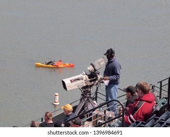 San Francisco -  April 14, 2010:  Cameraman, Fans, Kayaker watch baseball game at Att Park, California.
