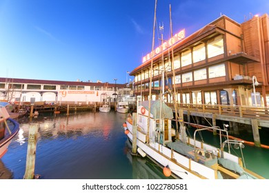 SAN FRANCISCO - AUGUST 6, 2017: Docked boats in Fisherman's Wharf port. This is a famous attraction for tourists.