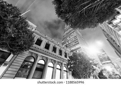 SAN FRANCISCO - AUGUST 6, 2017: City streets near Transamerica Building at night. They are a famous tourist attraction.