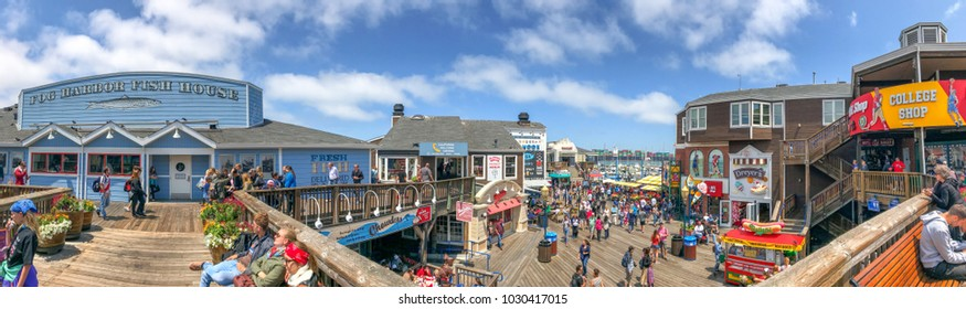 SAN FRANCISCO - AUGUST 7, 2017: Tourists in Fishermans Wharf area. The city attracts 25 million people annually.