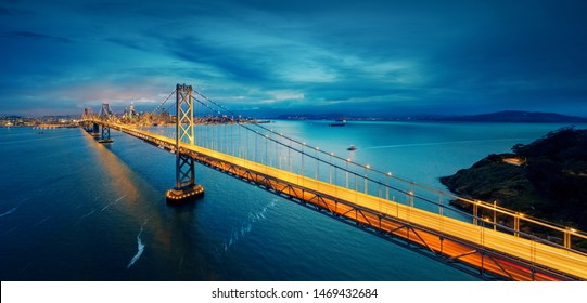 San Francisco Bay Bridge with Bay area in background. Famous bridge between Oakland and San Francisco city center. Panoramic aerial view.