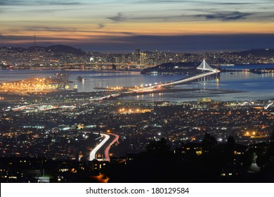 san francisco and bay bridge during sunset
