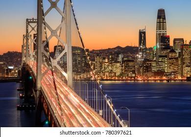 San Francisco Bay Bridge and Skyline at Dusk. Yerba Buena Island, San Francisco, California, USA.