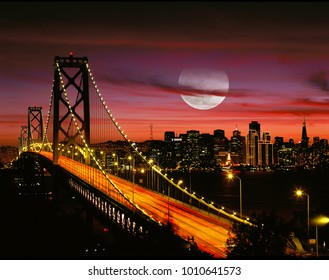 San Francisco Bay Bridge at Sunset with Colorful Sky, Full, Super Moon, and City Skyline