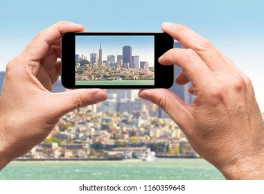 San Francisco bay, taking picture with smart phone, travel concept