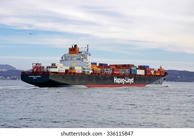 SAN FRANCISCO, CA -4 SEPTEMBER 2015- The Rotterdam Express cargo ship from the German transportation company Hapag-Lloyd stacked with containers in the San Francisco Bay.