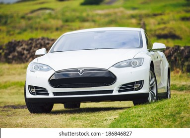 San Francisco, CA - April 2014: Tesla Motors model S sedan electric car on country road, Tesla's new Gigafactory would help Tesla increase its monthly production volume to 20,000 cars per month.