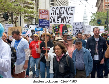 San Francisco, CA - April 22, 2017: March for Science, thousands of protesters march peacefully holding signs in the name of science protesting federal budget cuts that threaten scientific research.