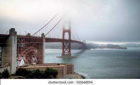 SAN FRANCISCO, CA - August 06, 2014: Thick fog covering Golden Gate Bridge