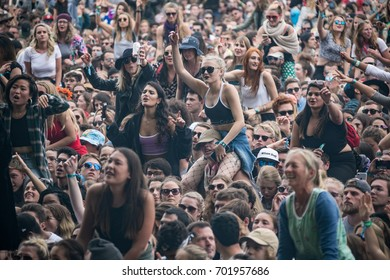 SAN FRANCISCO, CA - AUGUST 12, 2017: Women on man's shoulders shooting a selfie among fans  watching the band Cage The Elephant at the Lands End stage at the Outside Lands Musicl at Golden Gate Park.