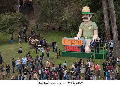 SAN FRANCISCO, CA - AUGUST 12, 2017: Fans taking photos at the iconic Ranger Dave icon at the Outside Lands Music and Arts Festival at Golden Gate Park on August 12, 2017 in San Francisco, California.