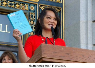 San Francisco, CA - August 26, 2019: County assessor Carmen Chu speaking at the 2nd annual Women's Equality Day Rally held on the steps of City Hall. The 99th anniversary of the 19th Amendment