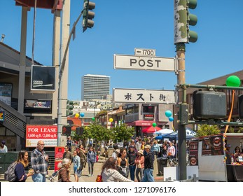 San Francisco, CA AUGUST 5, 2018: Post St sign in the heart of Japantown in San Francisco with a large crowd