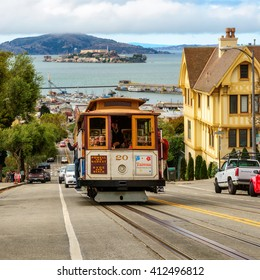 SAN FRANCISCO, CA - CIRCA JULY 2014 - Cable cars traffic in San Francisco, CA, circa July 2014. Cable car, an iconic tourist attraction