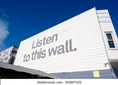 SAN FRANCISCO, CA - DECEMBER 10, 2015: Abstract art project in San Francisco has the words listen to this wall written on the side of a building.