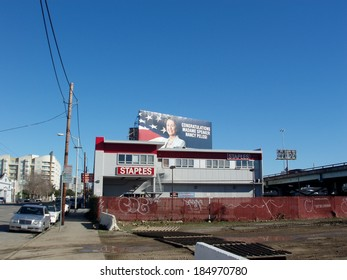 """SAN FRANCISCO, CA - DECEMBER 18:  Staples Office Supplies store and Billboard above it saying """"Congratulations Madame Speaker Nancy Pelosi"""" in SOMA on December 18 2006 in San Francisco California."""