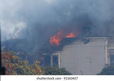 SAN FRANCISCO, CA - DECEMBER 22: Dark smoke and flames during a large fire of three apartment buildings on the corner of Golden Gate Ave and Pierce St. December 22, 2011 in San Francisco, CA