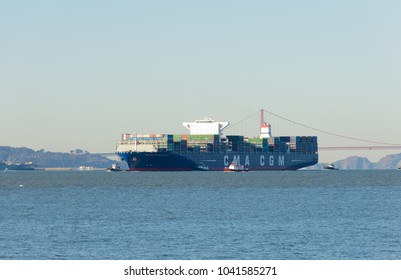 San Francisco, CA - December 31, 2015: The container ship the Benjamin Franklin, 10th largest container ship and the largest to visit the US arriving in San Francisco the morning of December 31
