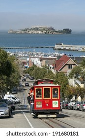 SAN FRANCISCO, CA - FEB. 28, 2013: A View of Cable Car and Alcatraz Island, both are the icons at the Bay Area in San Francisco, California.