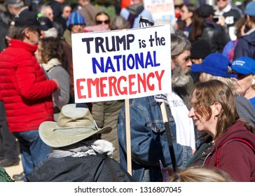 "San Francisco, CA - February 18, 2019: Unidentified Participants protesting President Donald Trump's national emergency declaration. Dubbed the ""Presidents Day Protest to Fight Trump's Fake Crisis."""