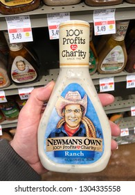 San Francisco, CA - February 2, 2019: Man holding a bottle of Newman's Own Ranch salad dressing inside a grocery store.