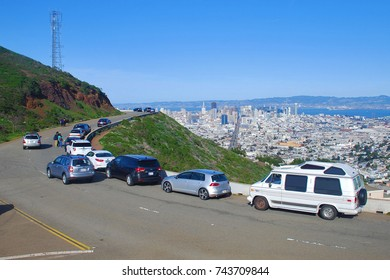 SAN FRANCISCO, CA - FEBRUARY 21, 2016: Sightseers, locals, and tourists park alongside Twin Peaks Blvd, overlooking the Financial District of San Francisco