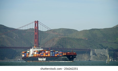 SAN FRANCISCO, CA - FEBRUARY 26, 2015: Hapag-Lloyd Cargo Ship KOBE EXPRESS entering the San Francisco Bay under the Golden Gate Bridge on its way to the Port of Oakland.