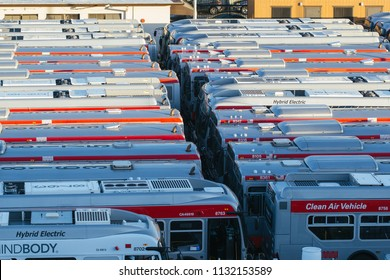 San Francisco, CA - July 8, 2018: Bunch of Hybrid Electric public transportation busses in San Francisco. Clean air vehicles.